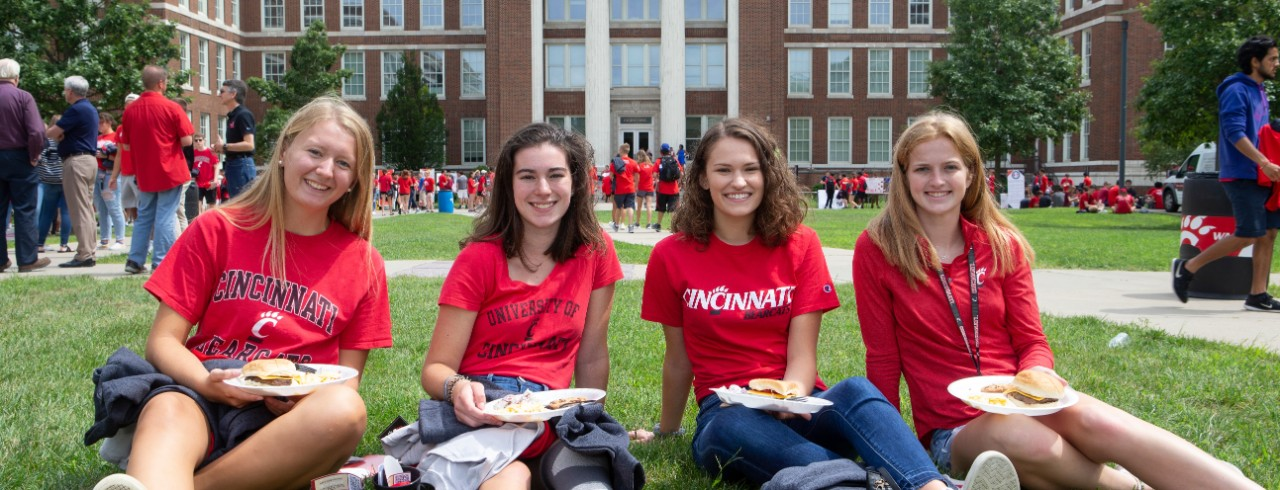 Students sitting on the lawn on Welcome Day