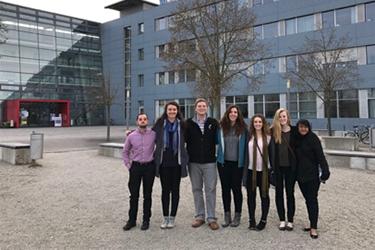 Seven UC students pose outside Technical University of Munich