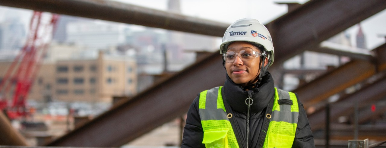 Student in hard hat at co-op site